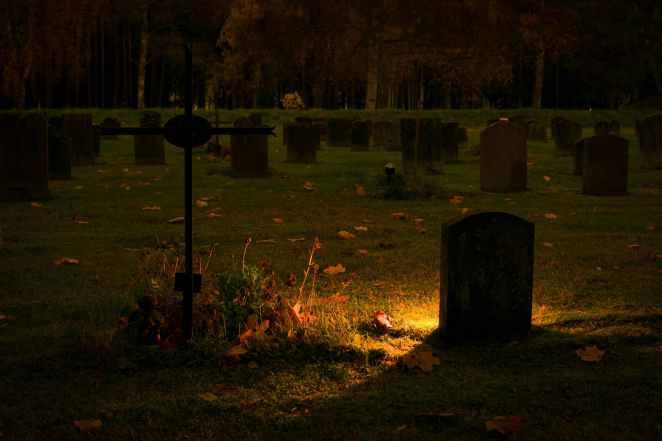 CemeteryWithLanterBehindHeadstone